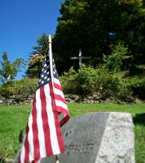 American Flag in cemetary with Cross