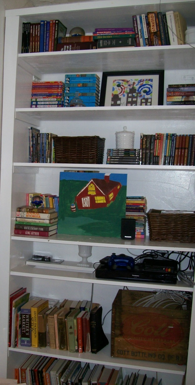 Bookshelves styled with kid's art