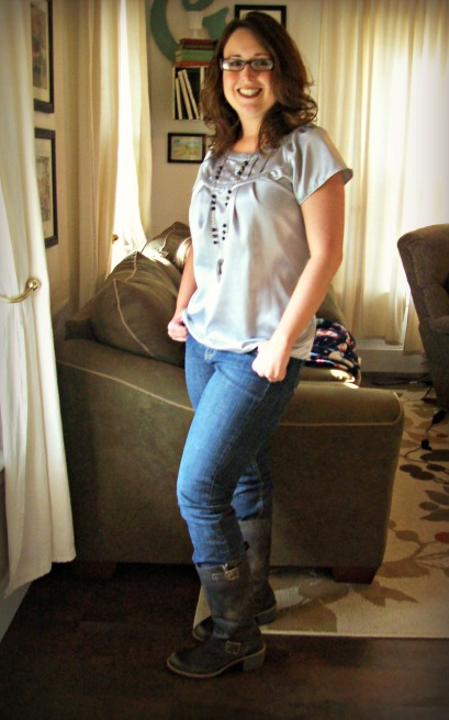 Jeans and boots and silver top
