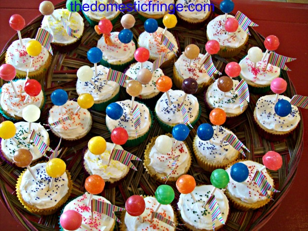 platter of birthday cupcakes with lolli-pops