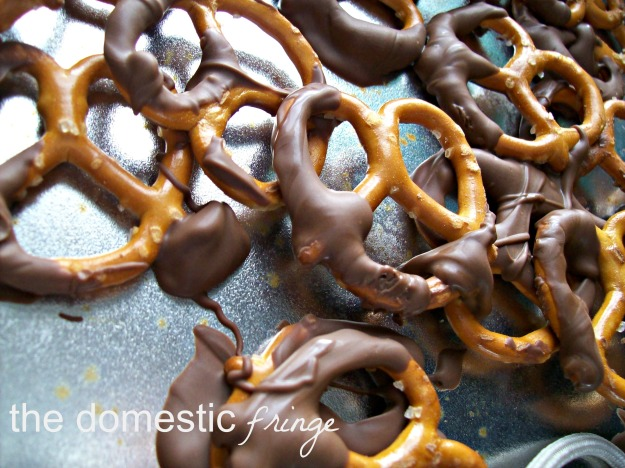 chocolate dipped pretzels in a pan