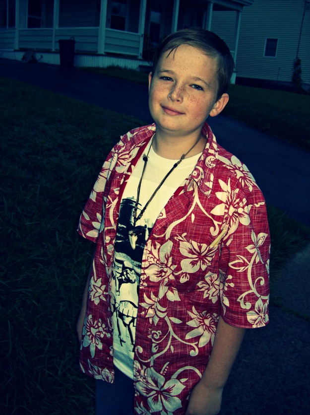 boy in Hawaiian shirt