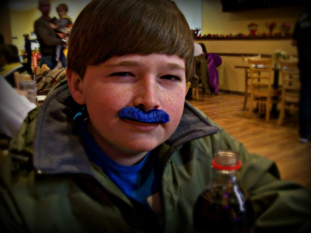 boy with a blue mustache