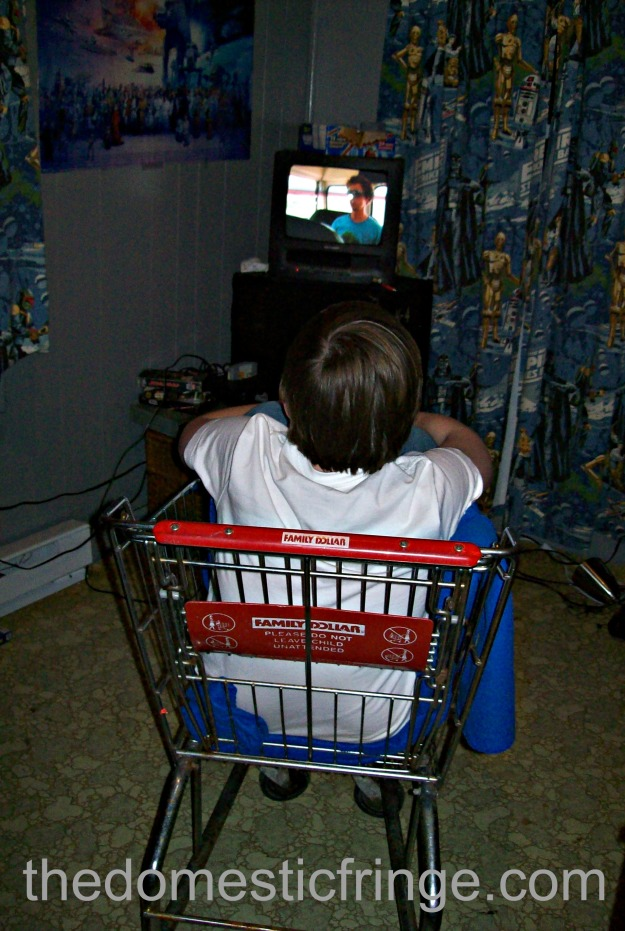 Kid in shopping cart