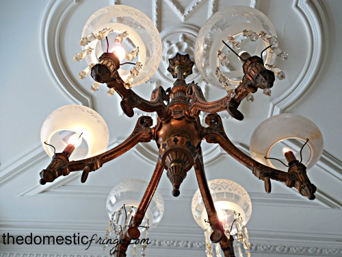 vintage lighting fixture on old tray ceiling